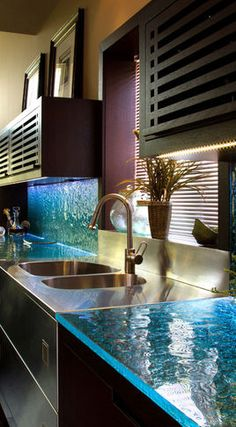 Contemporary glass kitchen counter tops....so cool:)