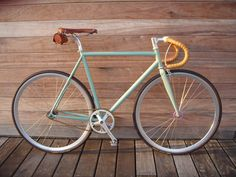 hipsterbike with:  – Hand laced deer hide handle bars  – Custom powder coated Italian steel  – Japanese tires with tan side-walls and custom checkerboard pattern  – Japanese brass bell  – Paul Components brake levers  – Rare Campagnolo brakes  – Custom radial-laced wheels  – Custom anodized pink wheel hubs  – Brooks leather saddles with titanium parts  – Sugino cranks