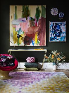 This is an eye-catching vignette... Big, bold works of colorful contemporary art and hung on a dark colored wall and really stand out! But - is too much attention diverted away from the larger piece to the two set off to the side? Or is it a smart and funky way to add interest? Would you #LoveItOrForgetIt?!?