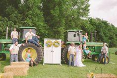 Wedding party posed on John Deere tractors for rustic wedding