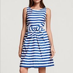 Kate spade Jillian striped bow dress this Kate spade is gorgeous!!! It features a beautiful v-neck, fully lined, zip up the back, gorgeous bow in the front, pleats in all the right places and made of cotton. It's in gorgeous condition except a vet slim line of light blue is on the white are in one place from the dry cleaners see picture. Price reflects statement necklace covers it kate spade Dresses
