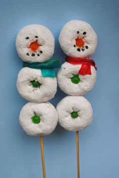 A kid friendly winter activity using donuts threaded on skewers to create snowmen treats. Snowmen on sticks are cute Christmas treats.