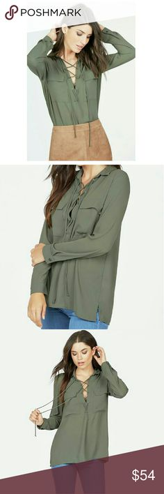 😎NWT Front Lace up Blouse A semi sheer lightweight blouse.  Features dual front pockets and a lace up front detail. Fabric Type: 100% Polyester Fabric Type Care: Hand wash cold. Do not bleach. Dry flat. Do not iron. NWT  XL12-14 Bust 40½-41½ Waist32-33 JustFab Tops Blouses