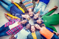 Multiethnic Group of People Holding Hands and Lying Down royalty-free stock photo
