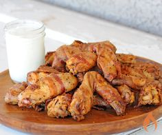 Do you like extra crispy chicken wings with lots of juicy flavor? Then, you gotta try bacon wrapped chicken wings because everything is better with bacon.