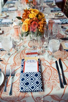 orange and navy blue table setting.