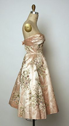 Dress, Evening  House of Balmain (French, founded 1945)  Designer: Pierre Balmain (French, St. Jean de Maurienne 1914–1982 Paris) Department Store: Bergdorf Goodman (American, founded 1899) Date: fall/winter 1956–57 Culture: French Medium: silk, beads.  Credit Line: Gift of Mrs. Samuel I. Newhouse, 1962!!!