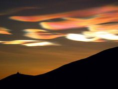 Nacreous clouds shine brightly in high altitude sunlight up to two hours after ground level sunset or before dawn. Their unbelievably bright iridescent colours and slow movement relative to any lower clouds make them an unmistakable and unforgettable sight.