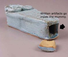This is where the written artifacts are placed in the mummy.  The cork is sealed using window caulk.  You can see more of my clay and painting lessons at www.johnpost.us/