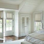 bedrooms - tongue and groove walls French doors linen roman shades white washed wood lamp  Monochromatic bedroom with tongue & groove walls,