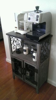 Coffee Bar: small space made beautiful. Cute little hutch I found at discounted price. I upcycled jars with spray paint & chalk board paint, put my coffee & espresso machine on top & viola!  May put shelves above for mugs.