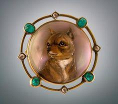 Reverse intaglio crystal brooch in diamond and emerald setting. English.