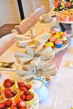 Alice in wonderland birthday party in blue yellow and pink tea party with finger sandwiches