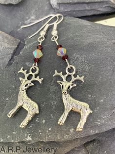 Christmas Earrings with a Reindeer and Three Swarovski Elements by ARPJewellery on Etsy