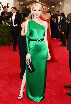 Emma Roberts in a shimmery green silk Ralph Lauren gown and bold red lips at the 2015 Met Gala