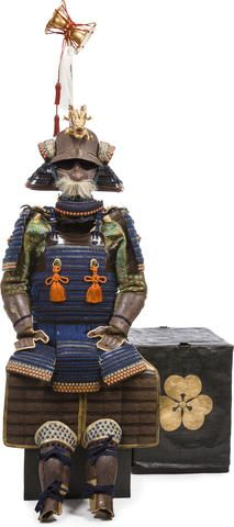 A black lacquer armor with an impressive standard Edo period (18th century) Laced in blue with white and orange trim and comprising a russet-iron sixty-two plate suji kabuto with a single iron shinodare running down the front plate and with a five-lame gilt-copper and shakudo tehen kanamono, the mabizashi fitted with a shakudo fukurin, the bowl fitted with a five-lame shikoro ending in fukigaeshi applied with stenciled leather, fusegumi and trimmed with gilt-copper fukurin,