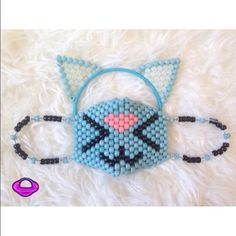 Kandi Blue Cat Ears & Mask Set Customize EDM EDM EDC RAVE KANDI Cat Mask and Ears Kandi Set Kitten Cat Mask Kandi Cat Ears Kandi Ears Glow in the Dark Kandi EDM Rave Gear Rave Wear Cat Eats Headband ✨ Cheaper shipping & 20% off only on Planetplur.etsy.com ✨ ❌NO TRADES, NO EXCEPTIONS❌ This is a custom handmade piece by Brittany Rey. Colors and size can be changed. Comment if you have any questions! Follow for more coupons: IG: @PlanetPlurOfficial Facebook: Facebook.com/PlanetPlur Planet Plur…