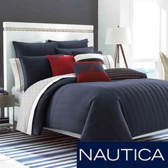 The Nautica Mainsail bedding set adds a modern touch to any bedroom decor. Featuring a solid navy pattern, the comforter reverses to a stripe design. This set also includes two standard shams and an optional Euro sham that is sold separately.