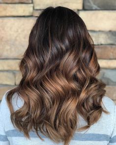 Dark chocolate brunette hair color with warm caramel sombre balayage by Aveda Artist Katie Bell. Retouch: 40g 3N, 4g Dk BV, 4g Dk YO, 40g 10volume. Balayaged with 20volume enlightener Toned: 40g 7n, 4g light yo, 4g vb, 4g bv, 40g cream