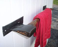 Towel Bar...AND IF AN INTRUDER TRYS TO GET IN MAKE SURE THE AXE IS EASILY REMOVEABLE! RP BY HAMMERSCHMID