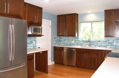 Image result for modern kitchen cherry cabinets