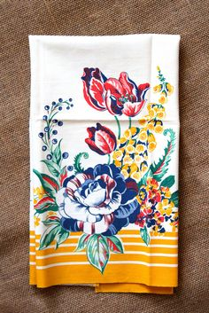 $18.00. Yellow is the prominent color in this vintage tea towel with an almost white background. Beautiful intricate floral design with light and dark blues, pink and maroon, mint and forest green.