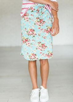 Floral mid length skirt. Elastic & Drawstring Waist. Fabric Content: 94% Polyester, 6% Spandex See Halle's sizing HERE, she is wearing size Small Paired here with THIS shirt.