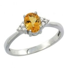 This stunning ring is made of 14K white-gold centered with all-natural, carefully-set Citrine stone accented with 3 Sparkling Diamonds on each side.