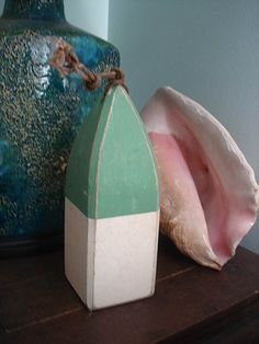 Vintage style Wooden Lobster Buoy. $12.00, via Etsy.