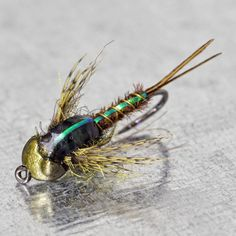 "flyfishfood: ""And here's a kicked up Drake version of a pheasant tail. Olive PT fibers and a @flymenfishingco Crawler head for Mr. Drunella nymph.…"