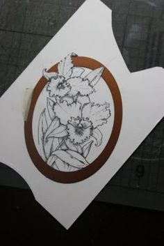 cut images out with shaped dies and leave one area hanging out of the die shape