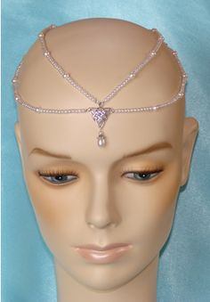 neverending empress headpiece with celtic triange. http://www.designerweddingjewelry.com/Page%20C%20Neverending%20Browband%20Silver.htm