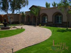 This clean traditional landscape design features Belgard pavers and a pre-cast water fountain in Scottsdale, AZ. - www.lonestaraz.com