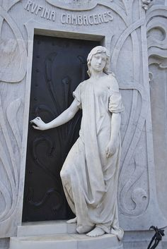 South America ... Sculpture outside of a tomb in the Recoleta Cemetery, Buenos Aires, Argentina.