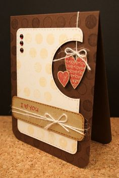 handmade Valentine:I{heart} you - Two Peas in a Bucket ...great design with a negative die cut circle going off the edge and two die ccut heats hanging in the empty spot ... brown and neutral colors ... good guy card ...