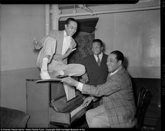 Duke Ellington at the piano, with dancer Charles 'Honi' Coles and Billy Strayhorn looking on, in the Stanley Theatre, c 1942-1943