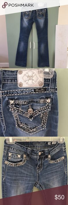 Miss me jeans 25 mid-rise boot Gorgeous large rhinestones front right pocket and both back pockets, Plus small crystal jewels and rhinestones in both back pockets and edges of front pockets. Very cool distressed areas on thighs knees front and back. I do accept reasonable offers at times depending what the item is and  it's worth. Miss Me Jeans Boot Cut