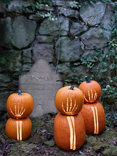These carved pumpkins look as if they're reaching from beyond the grave in your front yard. A perfect spooky way to scare your guests.