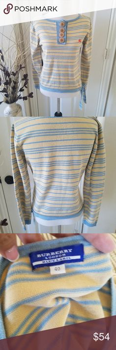 Burberry Blue Label Vintage Pullover This is a super cute vintage Burberry Blue Label pullover.  Large Tan colored Buttons.  Tan/Light blue stripped with a cute tie to one side.  Womens size 40 which is a US small.  Sweater has orange colored designer logo.  Does have some light fading of the tan color but it is in excellent condition and priced according.  Super cute. Burberry Sweaters Crew & Scoop Necks