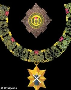 Insisgnia for the Order of the Thistle.The current order was founded in 1687 by King James VII of Scotland, also known as James II of England.The Sovereign grants membership to the order, and need not seek approval from the Govt. The motto of the order is Nemo me impune lacessit, which is translated as No one attacks me with impunity, or: No one can harm me unpunished.The emblem is a thistle, Scotland's national flower. The Queen, Prince Philip and Princess Anne are Knights of the thistle.