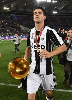 Alvaro Morata of Juventus FC celebrates the victory after the TIM Cup match between AC Milan and Juventus FC at Stadio Olimpico on May 21, 2016 in Rome, Italy.