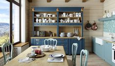 Farmhouse style dining space and kitchen with a fabulous hutch in blue