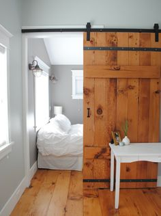 BORN AND BREAD: Barn Doors. Every time Jeff talks about getting a studio apartment one day, all I can think about is how to divide the Bed from the rest of the room without looking tacky. This would work.