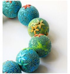 Today, we focus on elements that make up a finished piece. These beads by Maria Belkomor feature microbeads that give the appearance of tiny textured worlds. Please zoom in to catch the details! You can see Maria's LiveJournal link at The Polymer Arts Blog, http://www.thepolymerarts.com/blog/10092