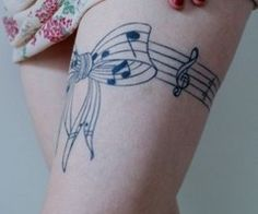 Bar of music tied into a bow - clever!    #tattoo