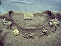 what a great idea. I'm going to do this with old vintage pins I have to create a necklace look!