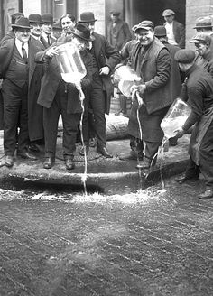 NYC Liquor Raid: Izzy Einstein Agents Dumping Liquor Into Gutter, 1922