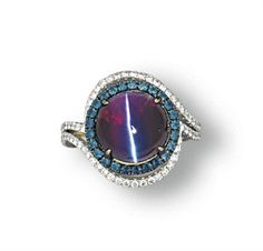 A CAT'S EYE ALEXANDRITE AND DIAMOND RING Set with a round-shaped cat's eye alexandrite weighing 5.40 carats, within an alexandrite trim to the pavé-set diamond surround and bifurcated half-hoop, mounted in platinum.