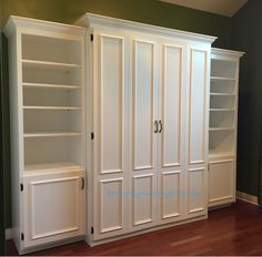 White painted MDF queen size Murphy bed, flat panel surface trimmed doors, two bookcases