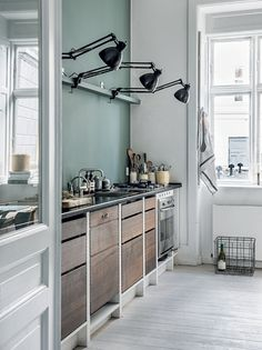 Kitchen with green wall in the small Copenhagen home of Aiayu co-founder Marie Worsaae